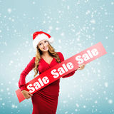 Christmas - Woman holds hands: Board on Sale subtitle Stock Images