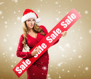 Christmas - Woman holds hands: Board on Sale subtitle Royalty Free Stock Photography