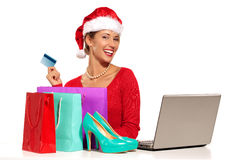 Christmas woman on laptop doing internet shopping Stock Images