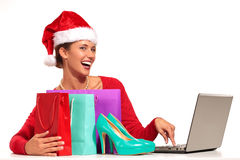 Christmas woman on laptop doing internet shopping Stock Photo