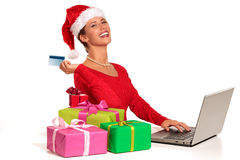 Christmas woman on laptop doing internet shopping Stock Image