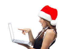 Christmas woman with laptop notebook in santa hat Royalty Free Stock Photography
