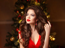 Christmas Woman. Long hair. Fashion earrings. Makeup. Beautiful Royalty Free Stock Photo