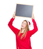 Christmas woman look at the chalkboard Royalty Free Stock Photo