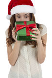 Christmas woman looking into gift box Royalty Free Stock Images