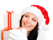 Christmas woman looking at present over white Royalty Free Stock Image
