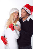 Christmas woman with loving gaze. Beautiful women with loving gaze toward her boyfriend. Christmas gift in the hand Stock Image