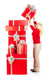 Christmas: Woman Making Huge Stack Of Gifts Stock Images