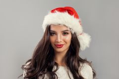 Christmas Woman Model wearing Red Santa Hat Royalty Free Stock Image