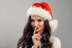 Christmas Woman Model wearing Red Santa Hat Royalty Free Stock Photos