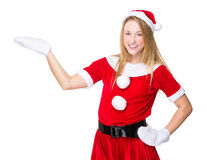 Christmas woman with open hand palm Royalty Free Stock Images