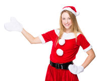 Christmas woman with open hand palm Stock Image