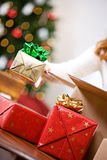Christmas: Woman Packing Gifts In Shipping Box Stock Photo