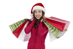 Christmas woman with paper shopping bags Royalty Free Stock Photo