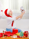 Christmas woman plaing with snowman toy Stock Photo