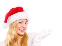 Christmas woman pointing at copyspace over white Stock Photos
