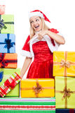 Christmas woman pointing at presents Stock Photo