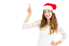 Christmas woman pointing to copy space Stock Photos