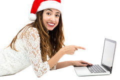Christmas woman pointing to laptop Stock Photos