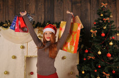 Christmas woman portrait  with gift packages. Christmas red girl near christmas tree winter fairy tale Royalty Free Stock Photo