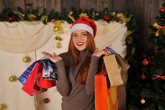Christmas woman portrait  with gift packages. Christmas red girl near christmas tree winter fairy tale Royalty Free Stock Image