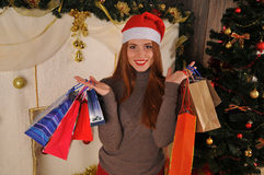 Christmas woman portrait  with gift packages. Christmas red girl near christmas tree winter fairy tale Royalty Free Stock Photos