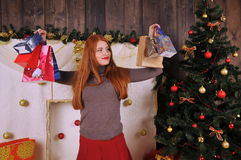 Christmas woman portrait  with gift packages. Christmas red girl near christmas tree winter fairy tale Stock Photography