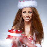 Christmas  woman portrait hold christmas gift. Royalty Free Stock Photography