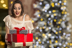 Christmas woman portrait holding christmas gift. Smiling happy g Stock Photo