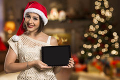 Christmas woman portrait holding tablet. Smiling happy girl over Stock Image