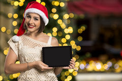 Christmas woman portrait holding tablet. Smiling happy girl over Stock Photos