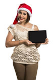 Christmas woman portrait holding tablet. Smiling happy girl over Stock Photo