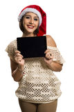 Christmas woman portrait holding tablet. Smiling happy girl over Stock Images