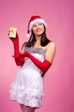 Christmas woman with present Royalty Free Stock Image