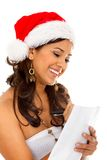 Christmas woman with present's list Royalty Free Stock Photos