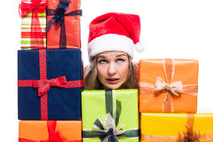 Christmas woman with presents looking up Royalty Free Stock Photos