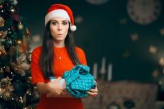 Christmas Woman Receiving Pajamas as Gift Royalty Free Stock Images