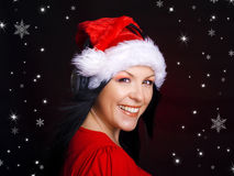 Christmas woman with santa cap and headphones Royalty Free Stock Image