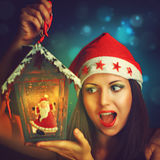 Christmas woman with Santa Claus lantern Stock Images