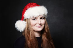 Christmas Woman in Santa Hat on Blackboard Stock Photos