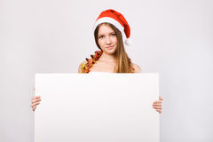 Christmas woman in santa hat with blank billboard Stock Photo