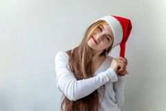 Christmas woman with Santa hat. Santa girl smiling in red Santa hat. Christmas Santa hat isolated woman portrait . Smiling happy girl on white background Royalty Free Stock Photos