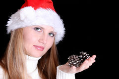 Christmas woman in santa hat  holding cones Royalty Free Stock Image