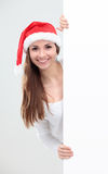 Christmas woman in santa hat holding empty board Stock Photography