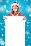 Christmas woman in santa hat holding empty board01 Royalty Free Stock Image