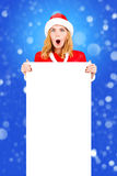 Christmas woman in santa hat holding empty board02 Royalty Free Stock Photo