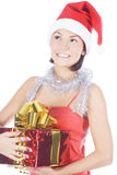 Christmas woman in santa hat holding gift Stock Photos