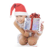 Christmas woman in santa hat holding gift Royalty Free Stock Photo