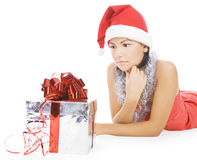 Christmas woman in santa hat holding gift Stock Image