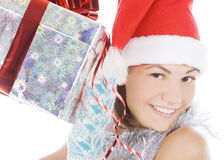 Christmas woman in santa hat holding gift Stock Photo